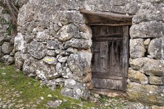 Very old weathered small door made of wood. Stone house Island Cres, Croatia stock photo