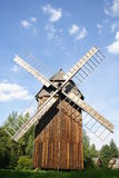 Very old windmill. Old windmill, made by wood, under blue sky Stock Photography