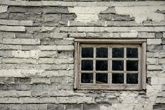 Very old window in the side of a farm house Stock Photography