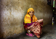 Very old woman begs in a local retirement home, Nepal Stock Photo