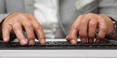 Very old woman typing on computer keyboard Royalty Free Stock Photography