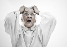 Neurotic grandma. Very old women tearing her hair Royalty Free Stock Photo