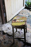 Very old wooden chair with iron pad on top Royalty Free Stock Image
