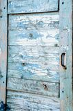 Very old wooden door with cracked and peeling blue paint stock photo