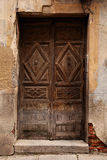 Very old wooden door and rundown brick Royalty Free Stock Photo