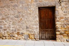 Very old wooden door and stone wall Royalty Free Stock Photos