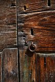 Old keyhole with iron ring Royalty Free Stock Photo