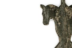 Very old wooden horse head isolated on white background. Decoration used for countryside house roof decor Stock Photo