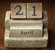Very old wooden vintage calendar showing the date 21st  April Royalty Free Stock Image