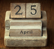 Very old wooden vintage calendar showing the date 25th April o Royalty Free Stock Image