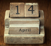 Very old wooden vintage calendar showing the date 14th April o Stock Photography