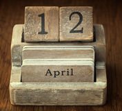 Very old wooden vintage calendar showing the date 12th April o Royalty Free Stock Photography