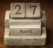 Very old wooden vintage calendar showing the date 27th April o Royalty Free Stock Photos