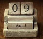 Very old wooden vintage calendar showing the date 9th April on Royalty Free Stock Photo