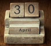 A very old wooden vintage calendar showing the date 30th April Stock Photography