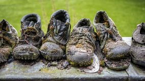 Very old work shoes. Weatherd old work shoes overgrown with moss as a symbol of impermanence Royalty Free Stock Photo
