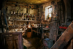 Very old workshop. Photograph of the interior of a very old workshop Royalty Free Stock Images