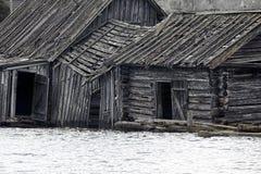 Very original houseboat village on lake. Abandoned wooden house. Very original houseboat village on lake, lake-habitation. Dying Russian village Royalty Free Stock Photos