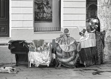 A very patricular fortune teller from Havana with a cigar. Cuba, Havana - 08 April, 2016: a beautiful, stylish fortune teller sitting during a siesta in one of Royalty Free Stock Photos