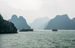 Boats in the mist in Halong Bay Stock Image