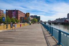 Very popular Boston Harborwalk , Boston, USA. Boston, Massachusetts, USA - July 15, 2016: Boston harbor promenade.  Boston Harborwalk is a public walkway that Royalty Free Stock Image