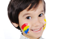 Very positive kid with colors Stock Photos