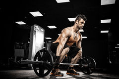 Very power athletic guy bodybuilder Royalty Free Stock Photo