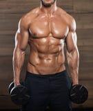 Very power athletic guy bodybuilder Royalty Free Stock Photo