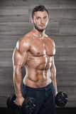 Very power athletic guy bodybuilder Royalty Free Stock Image