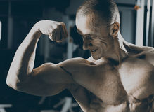 Very power athletic guy bodybuilder Stock Photos