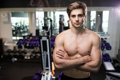 Very power athletic guy , execute exercise with dumbbells, in gym hall Stock Photography