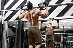 Man bodybuilder in gym Royalty Free Stock Photos
