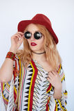 Very pretty girl with sunglasses and red hat Royalty Free Stock Photo