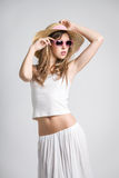 Very pretty girl with sunglasses. And straw hat Royalty Free Stock Photography