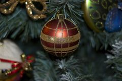 Glowing colorful chirtmas ball on the christmas tree Royalty Free Stock Photography
