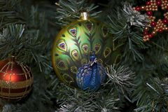Glowing colorful chirtmas ball on the christmas tree Royalty Free Stock Photo