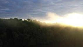 Aerial view of a Foggy Sunrise. A very rainy week created the perfect sunrise over a lake in the morning! Great views of farmland and fog stock video footage