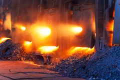 Very rare view of working open hearth furnace. Very rare close view of working open hearth furnace at the metallurgical plant stock photos