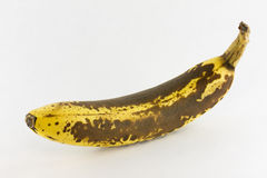 Very Ripe Banana. A Very Ripe Brown and Yellow Banana Stock Photography