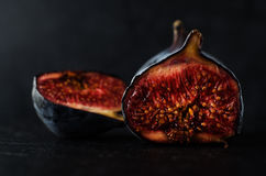 Very  Ripe Figs - Still Life on Black Royalty Free Stock Photography