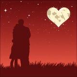 Very romantic moon. Lovers look at the very romantic moon Stock Photos