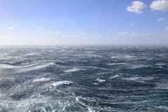 Very Rough Seas and Blue Skies. Storm Force Winds whip up the sea while the Sky remains a beautiful Blue Stock Image