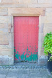 Very rustic green and red door Stock Photo