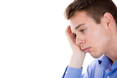 very sad, depressed, alone, disappointed man resting his face on hand Royalty Free Stock Images