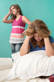 Very sad mother and her rebellious teenage daughter Royalty Free Stock Image