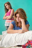 Very sad mother and her rebellious teenage daughter Stock Photo
