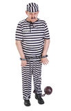 Very sad prisoner with ball and chain Royalty Free Stock Image