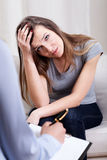 Very sad woman during therapy Stock Photos