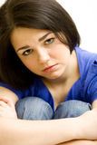 Very sad young girl. Sitting on the floor Royalty Free Stock Image