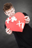 Very sad young man holding broken heart Royalty Free Stock Image